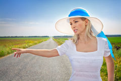 Woman with cash stops the car Royalty Free Stock Images