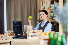 Woman by cashdesk Stock Images