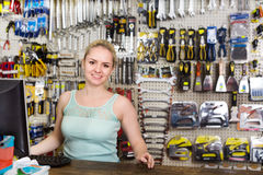 Woman cashier at pay desk Stock Image