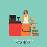 Woman cashier smiles and  standing in supermarket. Stock Images