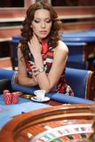 Woman in casino Royalty Free Stock Images