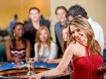 Woman in a casino Stock Photo