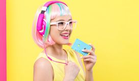 Woman with cassette tape and colorful wig royalty free stock photo