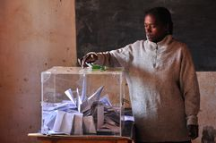 Woman casting her ballot. Voting. Madagascar 2013 elections Royalty Free Stock Images