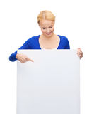 Woman in casual clothes with blank white board Stock Photo