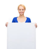 Woman in casual clothes with blank white board Stock Photography