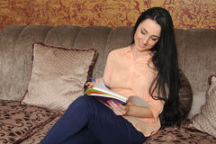 Woman in casual clothes makes entries in the diary Royalty Free Stock Photo