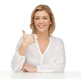 Woman in casual clothes. Picture of woman in casual clothes showing thumbs up Royalty Free Stock Image