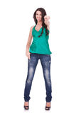Woman in casual clothes, pointing Stock Photography