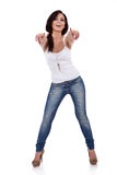 Woman in casual clothes, pointing at you Stock Images