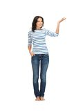 Woman in casual clothes showing direction Royalty Free Stock Photo