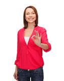 Woman in casual clothes showing ok gesture Royalty Free Stock Images