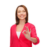 Woman in casual clothes showing ok gesture Royalty Free Stock Photography