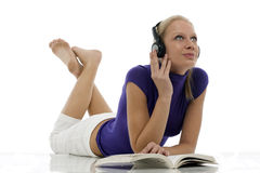 Woman with casual clothing with book and headphone Royalty Free Stock Image