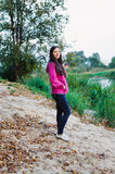 Woman in casual clothing standing of pond shore Royalty Free Stock Photography