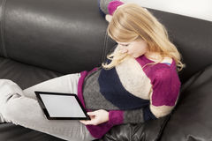 Woman in casual clothing with tablet PC Royalty Free Stock Image