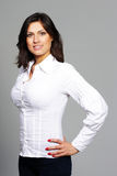 Woman in casual cloths over gray background Stock Photos