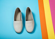 Woman casual gray leather shoes. On blue Stock Photos