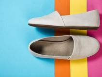 Woman casual gray leather shoes. On blue Stock Image