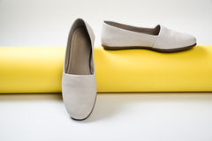 Woman casual gray leather shoes. On yellow Stock Image
