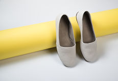Woman casual gray leather shoes. On yellow Royalty Free Stock Photo