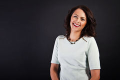 Woman in casual modern style on black background Stock Photos