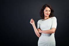 Woman in casual modern style on black background Stock Images