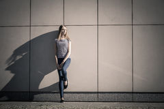 Woman casual style against stone grunge wall Royalty Free Stock Photography