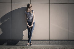 Woman casual style against stone grunge wall Royalty Free Stock Photos