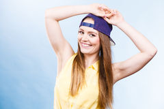 Woman casual style cap on head on blue. Fashion shot Royalty Free Stock Image