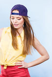 Woman casual style cap on head on blue. Fashion shot Stock Photography