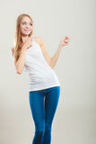 Woman casual style pointing copy space text area Stock Photography