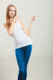 Woman casual style pointing copy space text area Stock Image