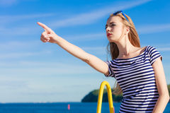 Woman casual style pointing on sky background Royalty Free Stock Image