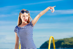 Woman casual style pointing on sky background Royalty Free Stock Photography