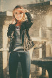 Woman casual style posing against city fountain Royalty Free Stock Photos