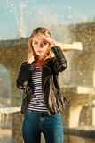 Woman casual style posing against city fountain Stock Image