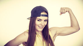 Woman casual style showing off muscles biceps Royalty Free Stock Images