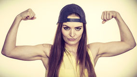 Woman casual style showing off muscles biceps Stock Images