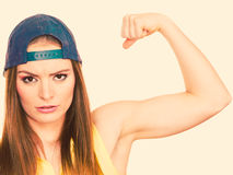 Woman casual style showing off muscles biceps Royalty Free Stock Photo
