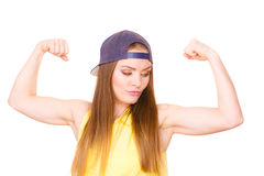Woman casual style showing off muscles biceps Stock Photography