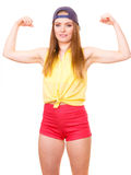 Woman casual style showing off muscles biceps Royalty Free Stock Image