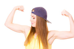 Woman casual style showing off muscles biceps Royalty Free Stock Photography