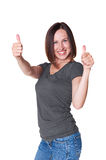 Woman in casual wear showing thumbs up Royalty Free Stock Photo