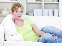 Woman in casuals on the sofa Royalty Free Stock Photos