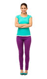 Woman In Casuals Standing Arms Crossed Over White Background Royalty Free Stock Image