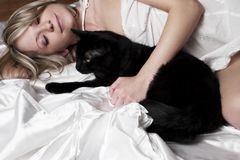 Woman with cat. Young woman with the black cat Stock Photo
