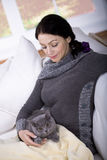 Woman and cat Stock Image