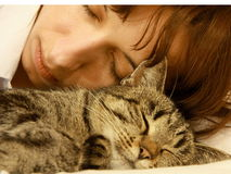 Woman with cat. Young woman with the cat stock photography