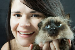 Woman and cat. Happy young woman with blue eyes cat Royalty Free Stock Image